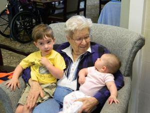 My mom with two of her great-grandchildren